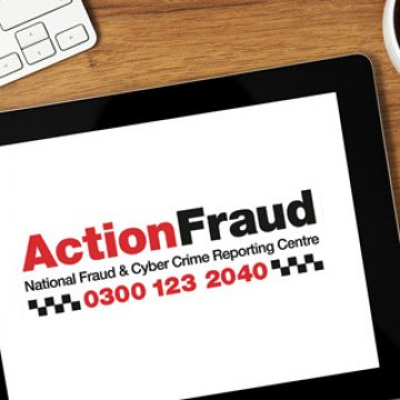 Action Fraud Logo show on a iPad on a desk